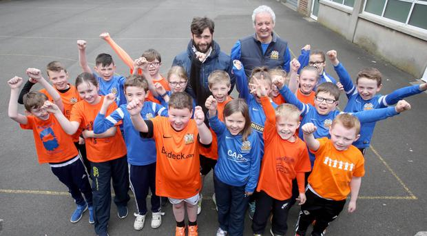 Glenavon manager Gary Hamilton and Eddie Drury with pupils from Carrick PS in Lurgan