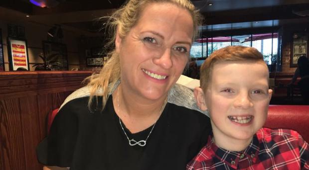 Staying positive: Cameron Eakins with mum Claire