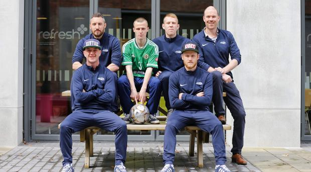 Justin McMinn and Aidan Byrne with players, from left, Roy Lillis, James Shaw, Gavin Martin and Gerard Bannon