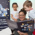 Bonding time: Jo Frost reading with children at the launch of Bath Book Bed in London
