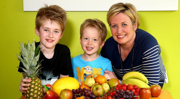 Fresh start: Ash Bingham, with her boys Toby and Cooper, are embracing a healthy diet