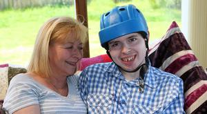 Motherly love: Lynne McKenzie and her son Adam who suffers from Lennox-Gastaut Syndrome