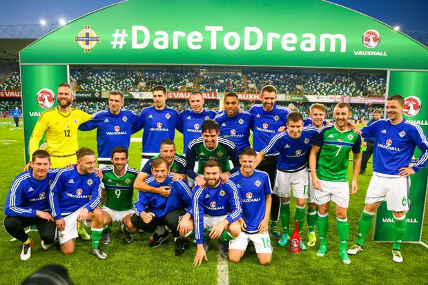 Pitch perfect: the Northern Ireland team celebrate their progress to the Euro 2016 Championship finals