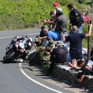 "Almost horizontal, right on the edge of the track, Michael Dunlop approaches the ""Gooseneck"" during the Monster Energy Supersport TT race on the Isle of Man"
