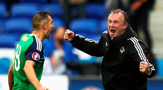 Jubilant Northern Ireland manager Michael O'Neill celebrates his team's second goal with Aaron Hughes during Thursday's tumultuous Euro 2016 Group C match against the Ukraine