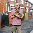 Helping hand: carer Andrew Johnston with Max the dog
