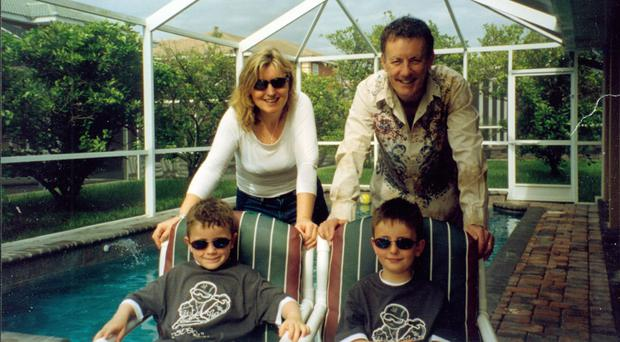 TV presenter Lynda Bryans and husband Mike Nesbitt with their sons PJ and Christopher during a holiday in Florida
