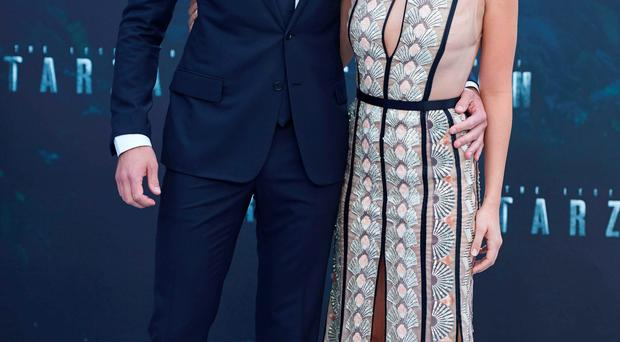 Alexander Skarsgard with his co-star Margot Robbie, who plays Jane, at the movie's premiere
