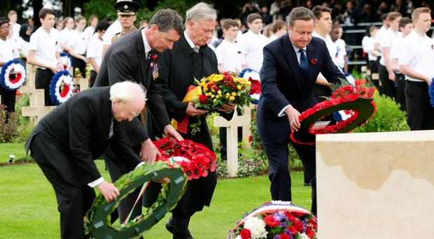 Mutual respect: Irish President Michael D Higgins (left) and Prime Minister David Cameron (right) at a wreath-laying ceremony in Thiepval, France