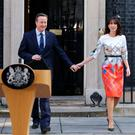 All change: Prime Minister David Cameron with wife Samantha