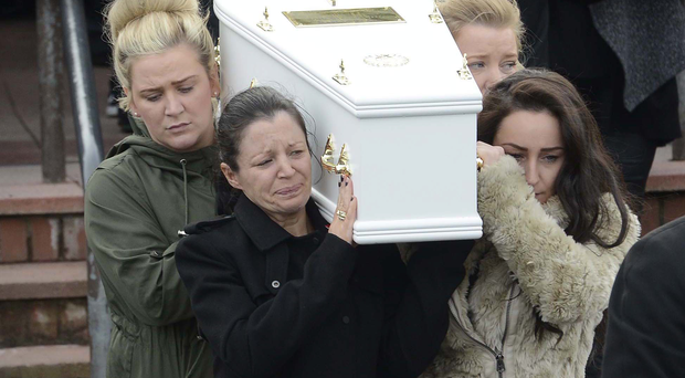 Louise James (front left) carries the coffin of one of her sons killed at Buncrana