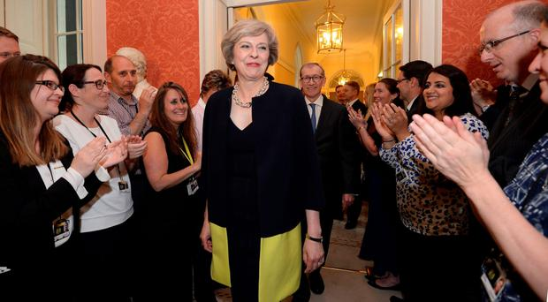 New dawn: Prime Minister Theresa May walks into 10 Downing Street