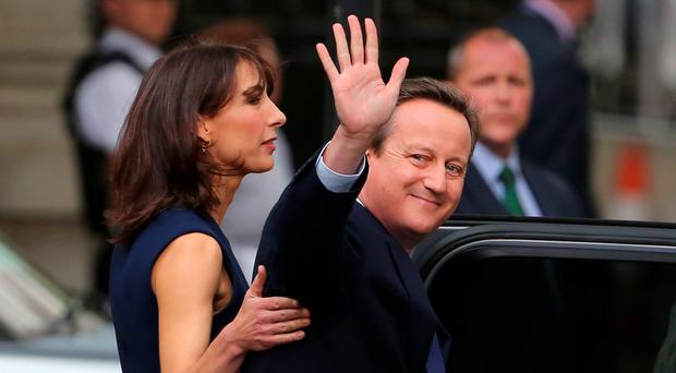 All over: outgoing prime minister David Cameron with his wife Samantha on his way to Buckingham Palace to tender his resignation to the Queen