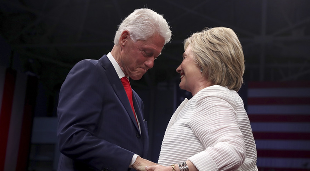 Hands of power: presidential candidate Hillary Clinton on the campaign trail with husband Bill at an event in Brooklyn, New York