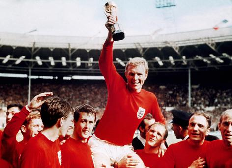 World beaters: from left to right: Alan Ball, Martin Peters, Geoff Hurst, captain Bobby Moore held aloft, Ray Wilson, George Cohen and Bobby Charlton