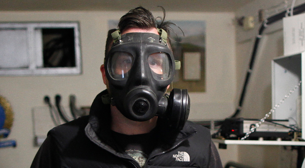Alistair McCann wearing a gas mask inside the Portadown monitoring base