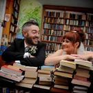 Novel approach: Lee Henry and Mairead on their wedding day surrounded by books