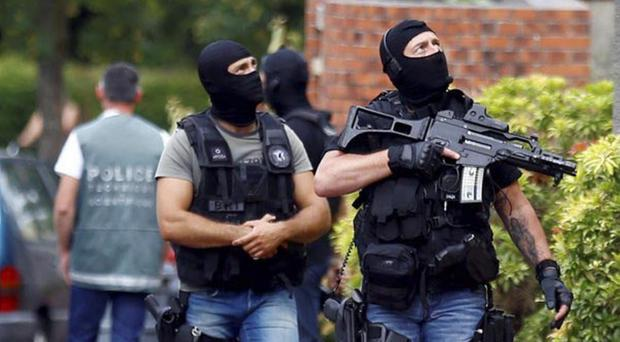 Fully armed: police officers conduct a search in Saint-Etienne-du-Rouvray in Normandy, France