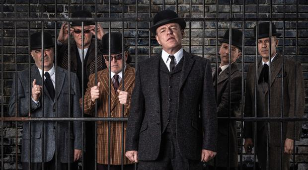 Mad men: Suggs (front) and the band