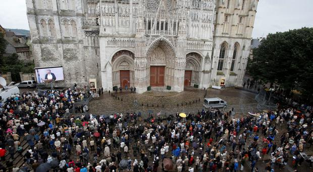 Disturbing death: a crowd outside Rouen cathedral in Normandy for the funeral Mass for Fr Jacques Hamel