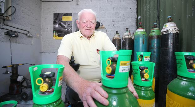Robert Murray, who lost both his legs, returns to work at the family business in west Belfast
