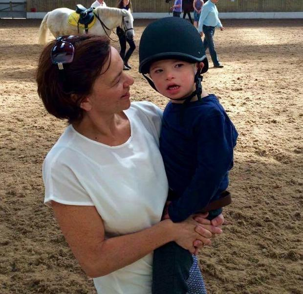 Saddle up: Theo gets horseriding lessons with mother Deirdre