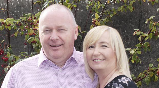 Early warning: James Campbell with his wife Fiona at their Portrush home