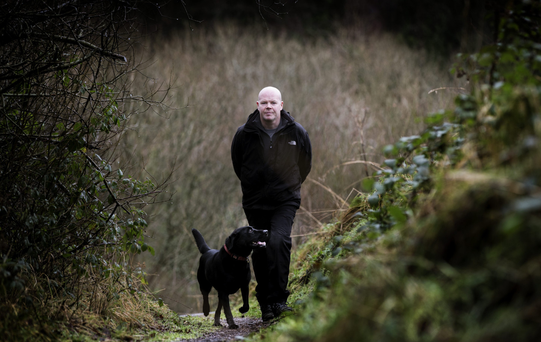 Special times: Anto Finnegan with his dog in Colin Glen Forest Park near Dunmurry