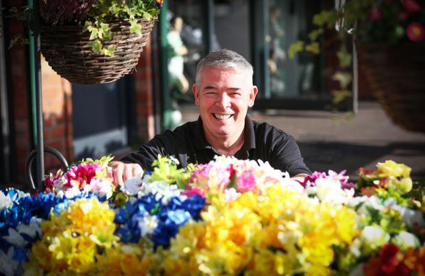 Florist Eddie McCormick with some of his creations