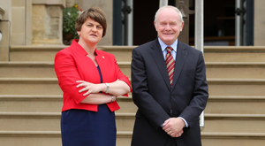 Good walk: Arlene Foster relaxes by venturing out in the countryside while Martin McGuinness takes his dog for a stroll