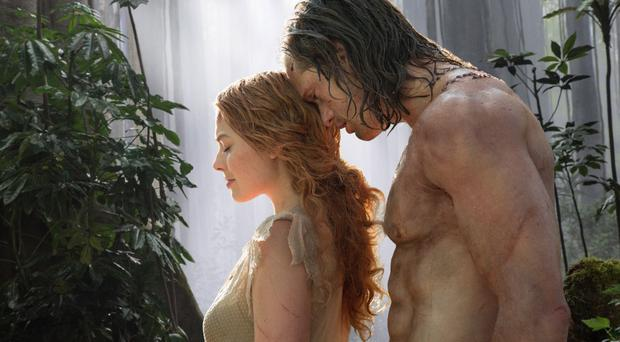 Margot Robbie and Alexander Skarsgard in Tarzan