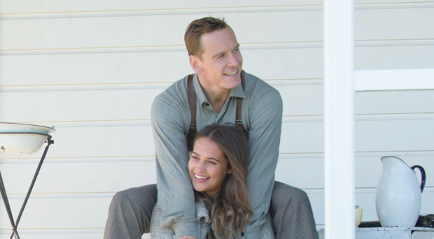 Loving embrace: Alicia Vikander sharing a tender moment with Fassbender