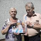 Denise Wilson and her husband Alan with a family photograph of Denise's mum Jessie Morton Smith