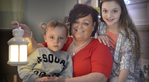 Lighting up: Sharon Mills with two of her six grandchildren Indi Maculey (4) and Brooke McKee (12)