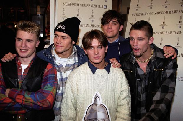 Five-star: Robbie (second right) with Take That back in 1993