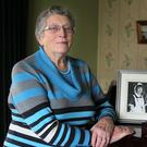Amazing spirit: Joan Wilson with a picture of her daughter Marie, who died in the 1987 Enniskillen bomb