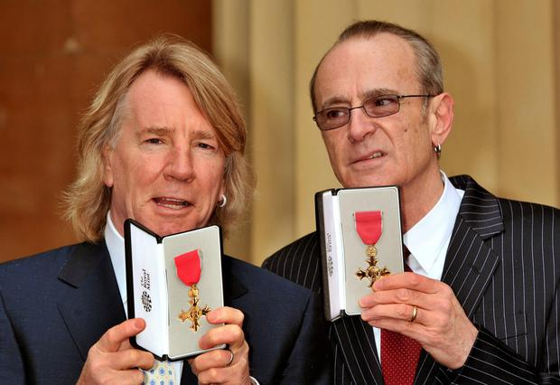 Rick Parfitt and Francis Rossi received OBEs in 2010