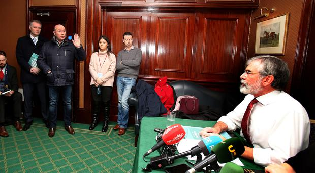 Stormy meeting: Austin Stack, son of murdered prison officer Brian Stack, confronts Sinn Fein president Gerry Adams at the party's launch of its Brexit document in Dublin's Davenport hotel