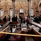 Mass murder: security forces examine the scene inside St Mark's Cathedral in Cairo following last week's bombing