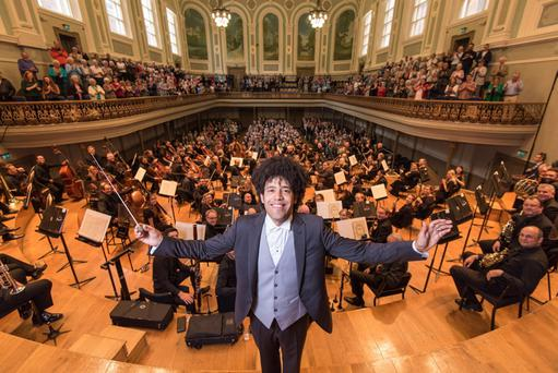 The full orchestra at the Ulster Hall with its principal conductor, Rafael Payare