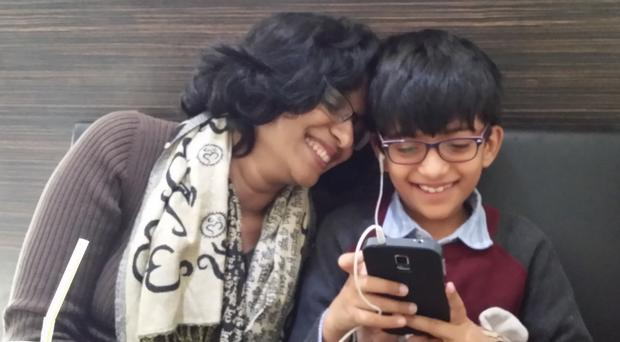 Ramya Kumar and her son Rishi, who has autism and a related learning disability