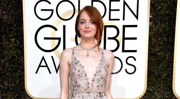 Awards season: Emma Stone at the Golden Globes in Beverly Hills last week