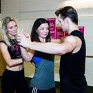 Baby steps: Jennifer (centre) learns a routine from cast members Carlie Miler (Penny) and Lewis Griffiths (Johnny)