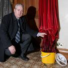 Easy target: David Gantley of St Patrick's Church, Belfast with curtains damaged in the arson attack