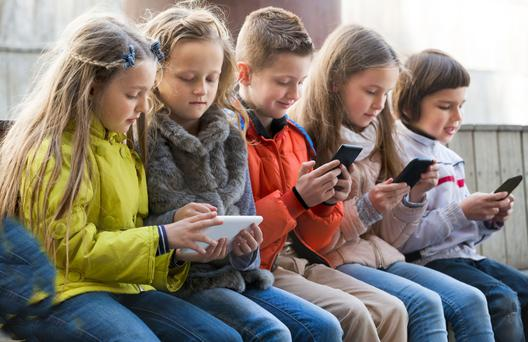 Staying connected: kids using smartphones and tablets