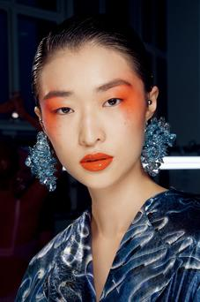 Heavenly hues: model backstage at Kenzo SS17 London Fashion Week