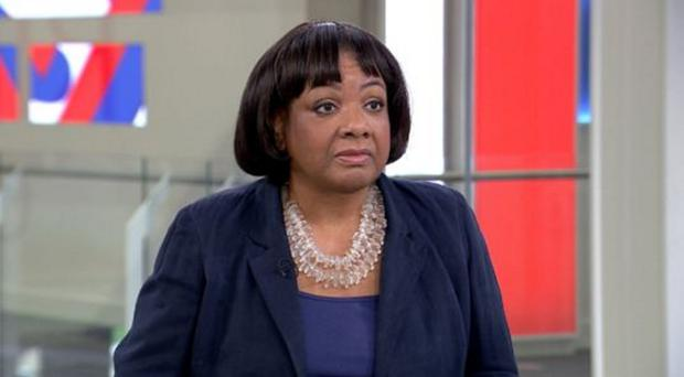 Brave face: Shadow Home Secretary Diane Abbott was insulted in a text by fellow MP David Davis