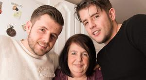 Twice as nice: Catrina Gamble and her twin sons Stephen (left) and Lee at her home in Londonderry