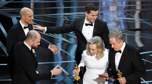 Mix up: La La Land producers Fred Berger, Jordan Horowitz and Marc Platt accept the Best Picture award due to a presentation error (the award was later given to 'Moonlight') from actors Faye Dunaway and Warren Beatty at the Oscars ceremony on Sunday night