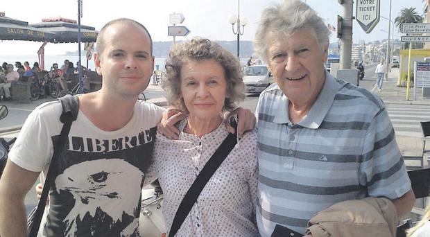 Family man: Jimmy Ellis with wife Robina and son Toto